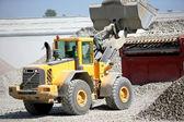Construction vehicles transporting gravel — Stock Photo