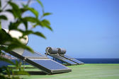 Solar panels by the coast — Stock Photo