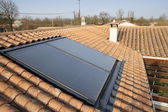 Solar panel on a house roof — Stock Photo