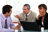 Man making point in business meeting — Stock Photo