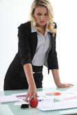 Businesswoman analyzing statistics — Stock Photo