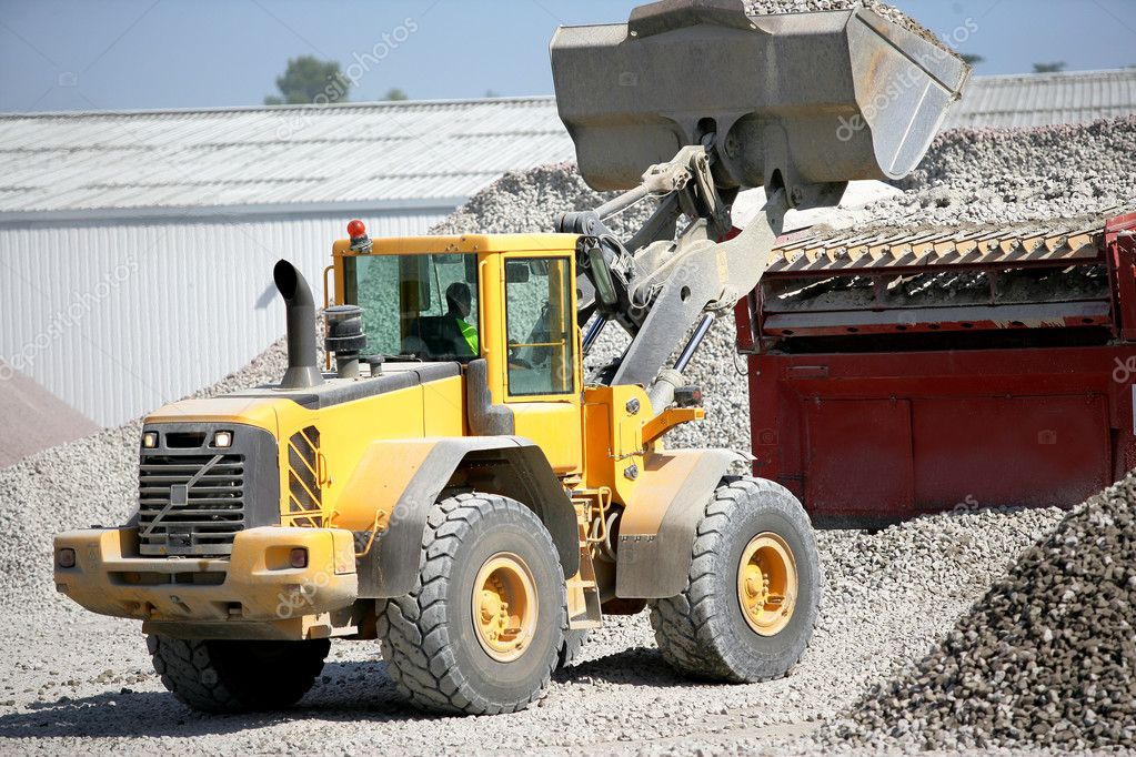 Construction vehicles transporting gravel  Stock Photo #11895918