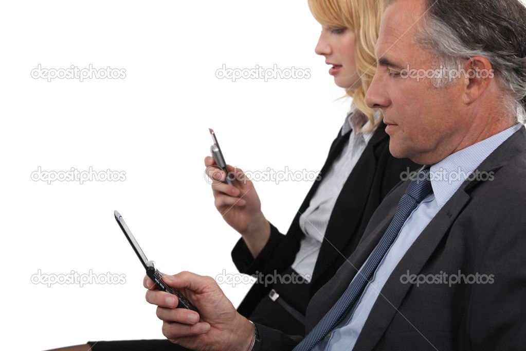 Business partner both checking e-mails on cellphone — Stock Photo #11898690