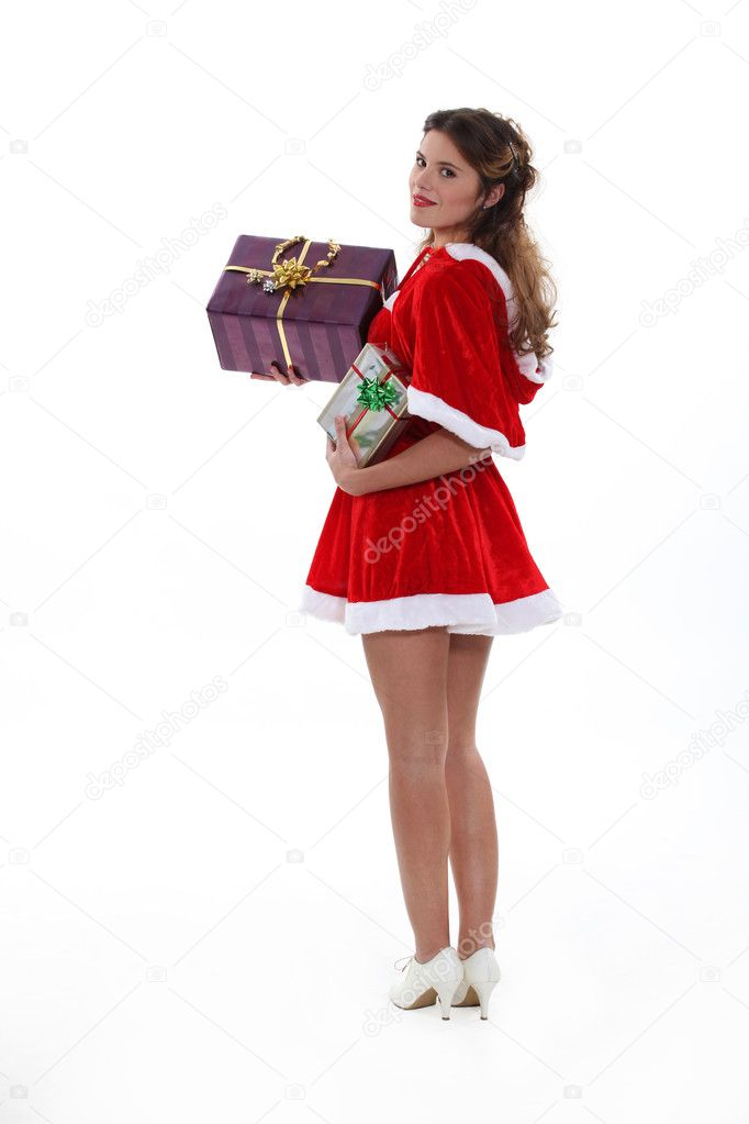 Saucy Miss Santa with Christmas presents — Stock Photo #11898910