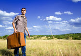 Young traveler in middle of nowhere — Stock Photo