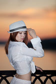 Young girl in a white shirt and hat — Stok fotoğraf