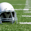 American Football Helmet on Field — Stock Photo