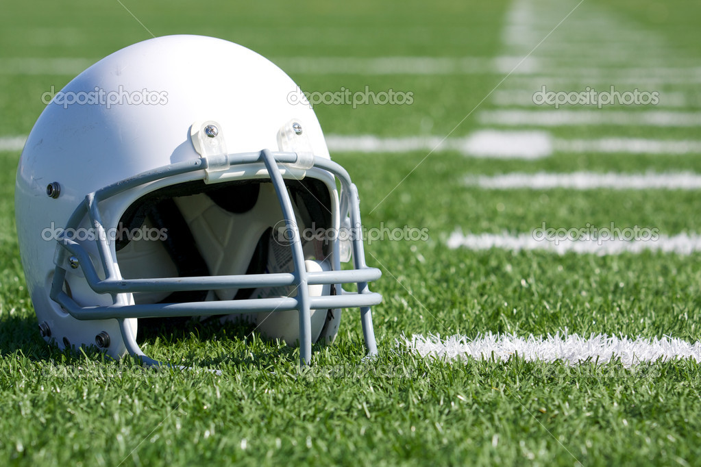 American Football Helmet on the Field with room for copy — Stock Photo #11737797