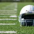 Stock Photo: AmericFootball Helmet on Field