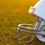 American Football Helmet on Field Backlit — Stock Photo #12329287