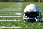 American Football Helmet on Field — Stock Photo