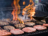 Grilling Hamburgers — Stock Photo