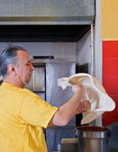 Pizza Making tossing crust — Stock Photo