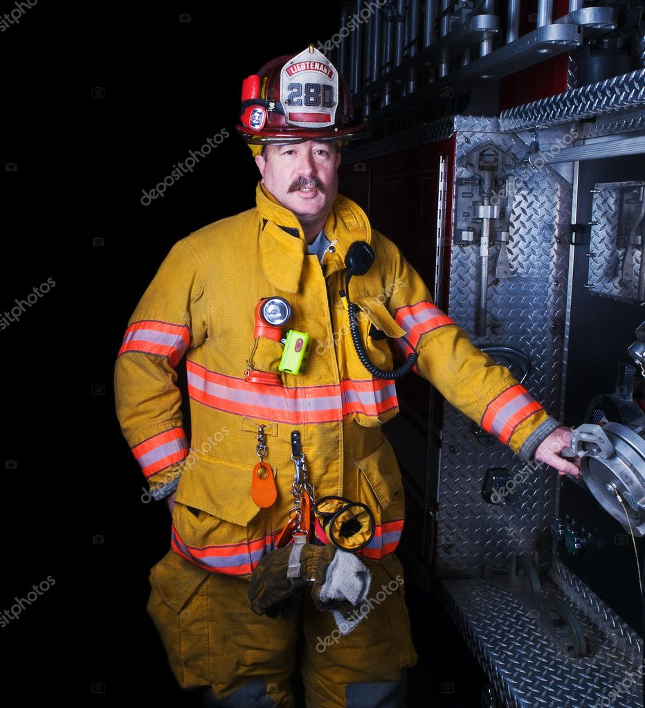 Portrait of a firefighter in turnout gear  Stock Photo #12412043