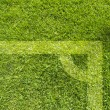 Plasticine Football on grass background — Lizenzfreies Foto
