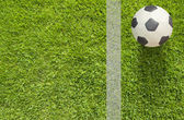 Plasticine Football on grass background — Zdjęcie stockowe