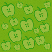 Apple on green grass background — Stock Photo