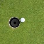 Golf Ball on Edge of Hole — Stock Photo
