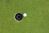 Golf Ball on Edge of Hole — Stock Photo