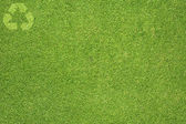 Recycle on Green grass, texture background — Stockfoto