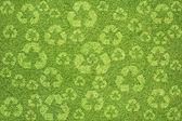 Yeşil çim dokusu ve arka plan üzerinde geri dönüşüm — Stok fotoğraf