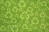 Recycle по зеленой траве текстуру и фон — Стоковое фото