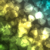 Shiny hearts bokeh light background — Stock Photo