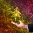 Tree of light with hand on abstract background - Stock Photo