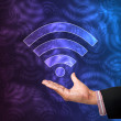 Wireless of light with hand on abstract background — Stock Photo