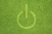 Shutdown icon on green grass background — Stock Photo
