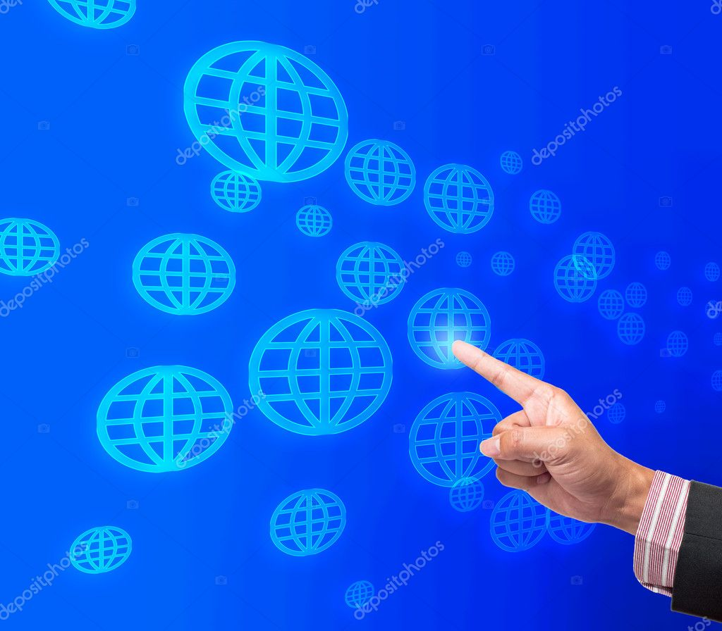 Hand pushing global button on a touch screen interface  Stock Photo #11942658