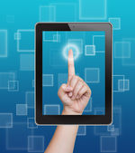 Hand pushing tablet on a touch screen blank interface — Stock Photo