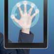Foto de Stock  : Hand pushing clock icon tablet on a touch screen blank interface