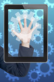 Hand pushing gear icon tablet on a touch screen blank interface — Stock Photo