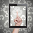 Hand pushing recycle button of tablet on a touch screen — Stock Photo