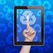 Hand pushing recycle button of tablet on a touch screen — 图库照片