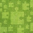 Jigsaw on green grass texture and  background — Stock fotografie