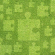 Jigsaw on green grass texture and  background — Стоковая фотография