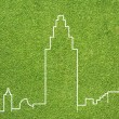City on green grass texture and  background — Photo