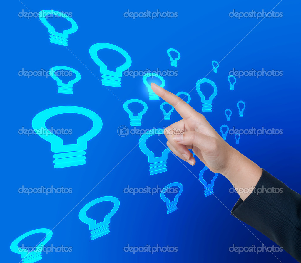 Hand pushing bulb light button on a touch screen interface — Stock Photo #12193918