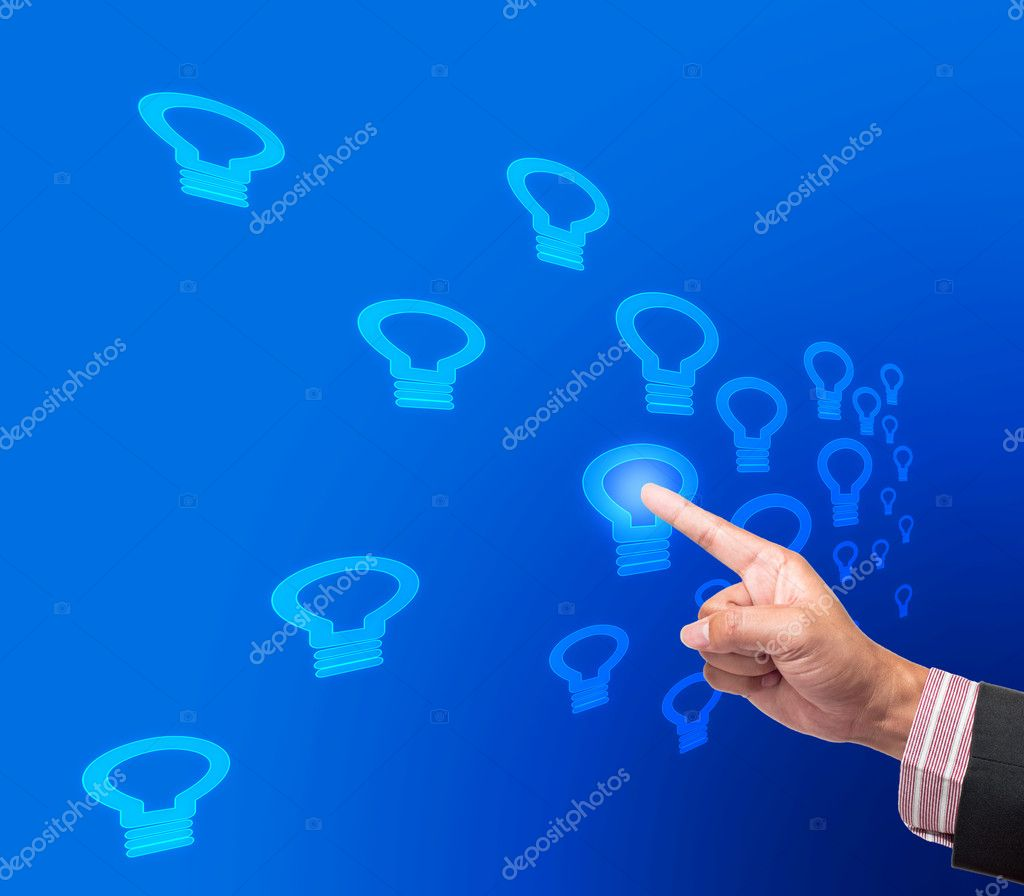 Hand pushing bulb light button on a touch screen interface  Stock Photo #12193962