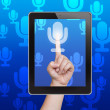 Hand pushing microphone button of tablet on a touch screen - Stock Photo