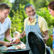 Stock Photo: Family having a barbecue party
