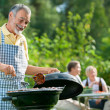 Family having a barbecue party — Stock Photo #11958157