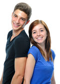 Teenage couple standing back to back — Stock Photo