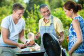 Family having a barbecue party — Stok fotoğraf
