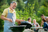 Family having a barbecue party — Stock Photo