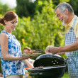 Family having a barbecue party — Stock Photo #12067789