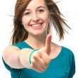 Female teenager shows a thumbs up — 图库照片