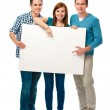 Group of teens with a banner — Stock Photo